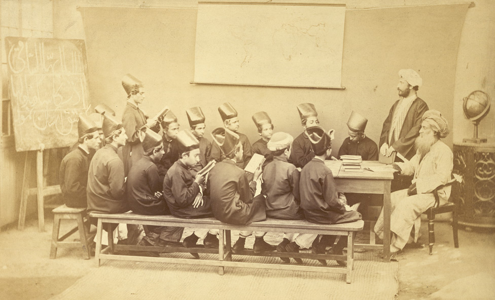 Group of Parsee pupils and masters in class of the Elphinstone High School, Bombay